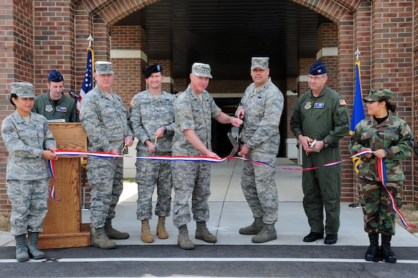 Maj. Gen. Winfield W. Scott III, 18th Air Force commander, and Col. Greg Otey, 19th Airlift Wing commander, prepare to cut the ribbon to the new 19th Maintenance and Operations Group building at Little Rock Air Force Base April 16, 2009. Joining General Scott and Colonel Otey from left is Col. Chris Hair, 19th Maintenance Group commander, Col. Donald Jackson, U.S. Army Corp of Engineers district engineer and Col. Jeffrey Hoffer, 19th Operations Group commander. (U.S. Air Force photo by Senior Airman Steele Britton)
