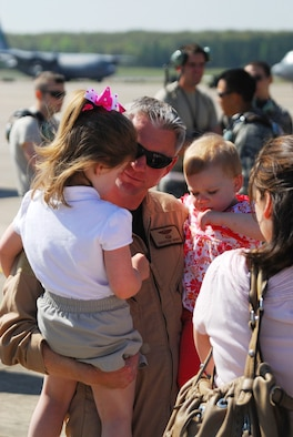 Maj. Christian Garber, a 41st Airlift Squadron pilot, meets with his children and wife following his return to Little Rock AFB from a deployment April 16, 2009. (U.S. Air Force photo by Staff Sgt. Juan Torres)