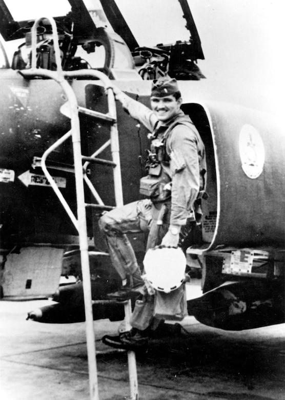 Lance Sijan climbing into an F-4. (U.S. Air Force photo)