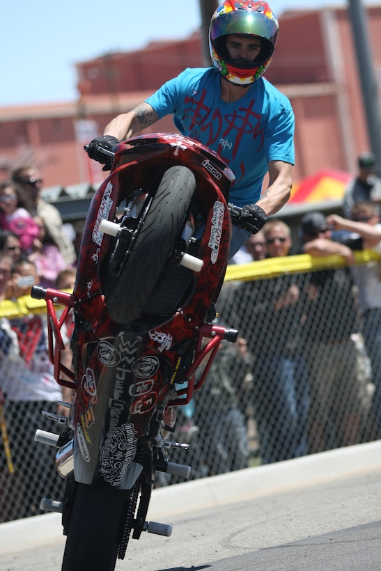Jef Groff, a stunt rider, rides a wheelie in circles during The Few, The Proud, The Xtreme show at Victory Field April 25.