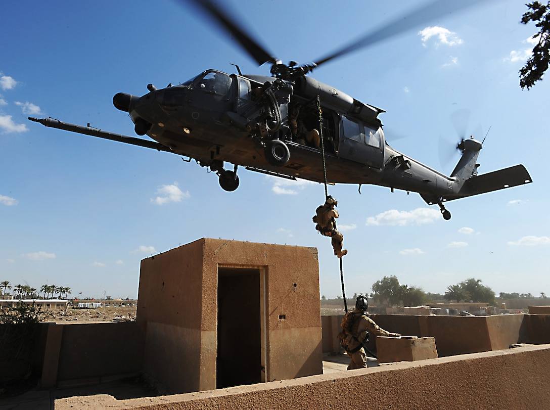 A pararescueman fast ropes from an HH-60 Pave Hawk helicopter to join a team member in a proficiency exercise outside of Baghdad, Iraq. They are assigned to the 64th Expeditionary Rescue Squadron at Joint Base Balad, Iraq.  (U.S. Air Force photo/Staff Sgt. James L. Harper Jr.)