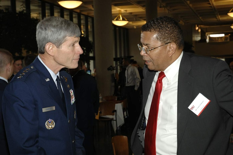 Mr. Frank Anderson, president of Defense Acquisition University, chats with Gen. Norton Schwartz, Air Force chief of staff, April 21 during DOD Acquisition Insight Days at Sinclair Community College in Dayton, Ohio. The event featured workshops, training and a forum for Air Force acquisition professionals to discuss the latest regulatory changes and ideas for speeding the delivery of new capabilities for joint warfighters. (U.S. Air Force photo/Al Bright)