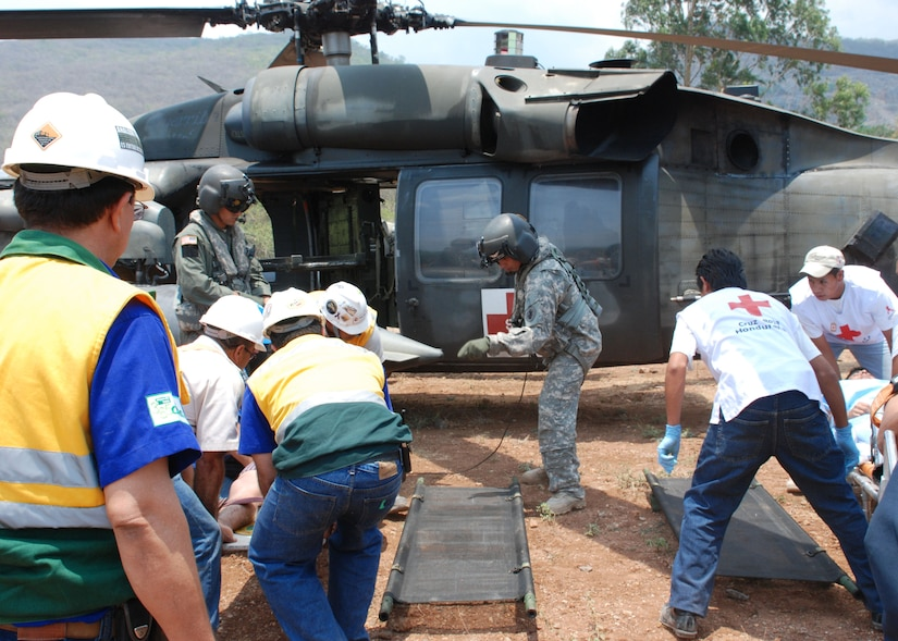 COMAYAGUA, Honduras - During an exercise at La Farge Cement Factory April 22, U.S. Army Sgt. Clayton Peterson (center), a flight medic from Joint Task Force - Bravo, directs the placement of accident victims for medical transport via HH-60 Blackhawk helicopter.  JTF-Bravo participated in FA-HUM '09 this week, a multinational exercise for disaster response agencies throughout Central America.  (U.S. Air Force photo/Tech. Sgt. Rebecca Danét)