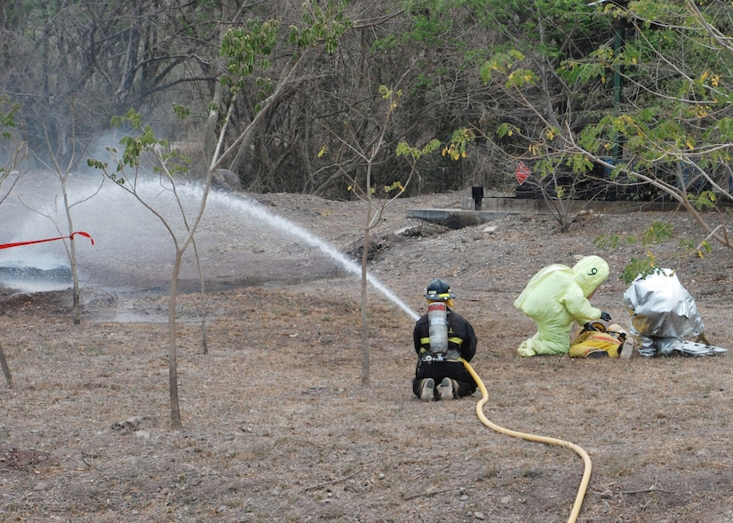 COMAYAGUA, Honduras - Firefighters, HazMat crews and military members responded to a simulated explosion at La Farge Cement Factory here April 22, in which three simulated victims were seriously injured.  First responders from throughout Central America were here this week to participate in FA-HUM '09, a multinational disaster response exercise coordinated by COPECO, Honduras' disaster response agency.  (U.S. Air Force photo/Tech. Sgt. Rebecca Danét)