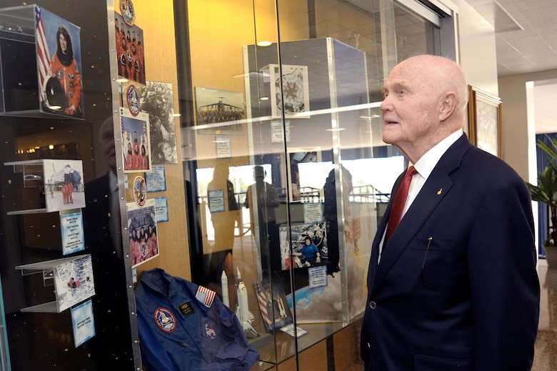 Sen. John Glenn admires a display case April 22 featuring U.S Air Force Academy graduate Brig. Gen. Susan J.  Helms.  He was visiting the Academy to be honored as the recipient of the 2008 Thomas D. White National Defense Award.  (U.S. Air Force photo/Mike Kaplan)