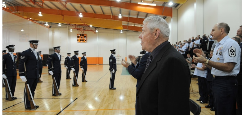 """Fifth Chief Master Sergeant of the U.S Air Force Robert Gaylor watches The U.S Air Force Honor Guard Drill Team performs along withThe U.S Air Force Band's rock band """"Max Imapact"""" after his opening speech 20th April Boo Sportsplex Hampton, Va. In retired Chief Gaylor's speech he commented on The Band of Sisters, his time during WWII, the Vietnam war, and where our Airman are now during Air Force weeks Honoring America's Veterans Ceremony. (U.S. Air Force photo by Senior Airman Alexandre Montes)"""