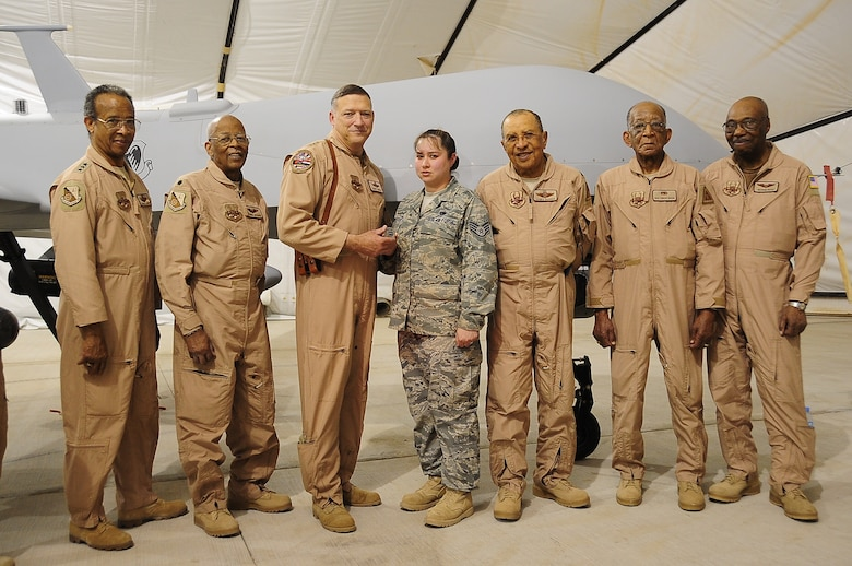 Staff Sgt. Christine Griffith was coined by Lt. Gen. Gary North, air component commander, U.S. Central Command, April 23 for Outstanding Performance. Several Tuskegee Airmen were also present to congratulate her.