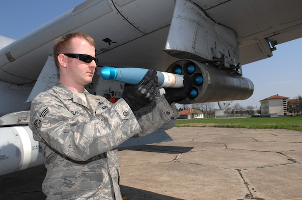 BEZMER AIR BASE, Bulgaria – Senior Airman Bryan Fleetwood, 52nd Civil Engineer Squadron Explosive Ordinance Disposal team, removes a training rocket from an A-10 aircraft.  Airman Fleetwood deployed to Bezmer Air Base, Bulgaria, to support a joint U.S. and Bulgarian Air Forces training exercise. (U.S. Air Force photo by Master Sgt. Bill Gomez)
