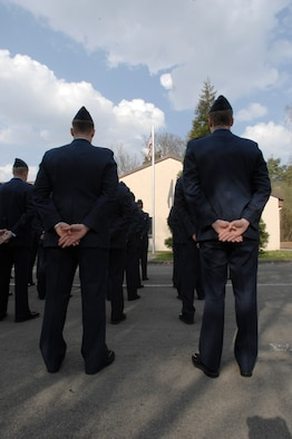 U.S. Air Force Airmen from the 76th Airlift Squadron stand in formation during the memorial service for the tragic loss of Implementation Force (IFO)-21, April 6, 2009, Ramstein Air Base, Germany.  The 76th AS hosts this memorial service every year.  (U.S. Air Force photo by Senior Airman Amber Bressler)