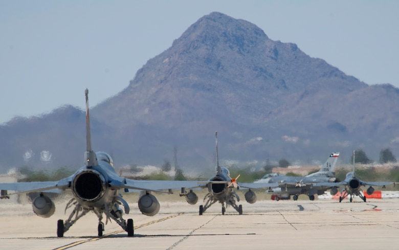 F-16 Fighting Falcons assigned to the 149th Fighter Wing from San Antonio depart for training sorties during Exercise Coronet Cactus April 24 at Davis-Monthan Air Force Base, Ariz.  The 149th Fighter Wing is a Texas Air National Guard unit and trains active duty F-16 Fighting Falcon pilots.  (U.S. Air Force photo/Master Sgt Jack Braden)
