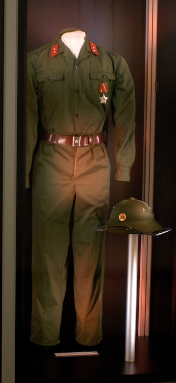 DAYTON, Ohio - North Vietnamese uniform of the type worn by prison guards on display in the Return with Honor: American Prisoners of War in Southeast Asia exhibit in the Southeast Asia War Gallery at the National Museum of the U.S. Air Force. (U.S. Air Force photo)