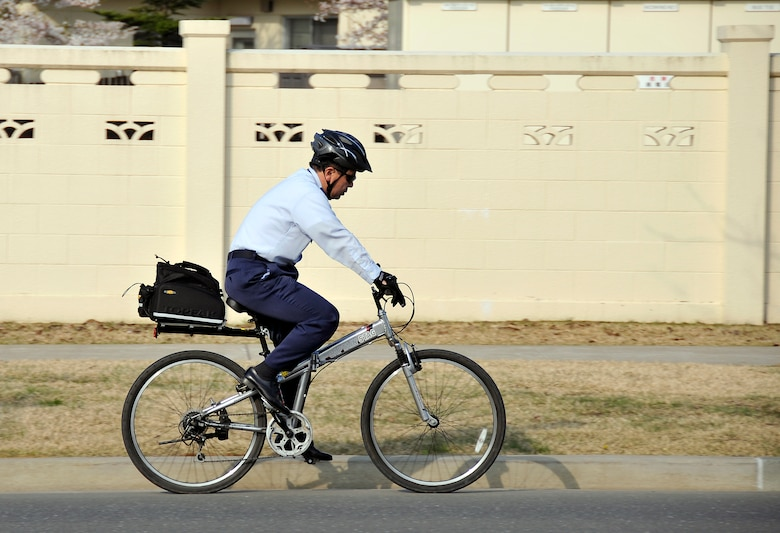 MISAWA AIR BASE, Japan -- An Air Force officer rides his bicycle to work on April 20, 2009. Bicycle safety and helmet use is mandated for all U.S. military, dependents and contractors.  (U.S. Air Force photo by Senior Airman Chad Strohmeyer)