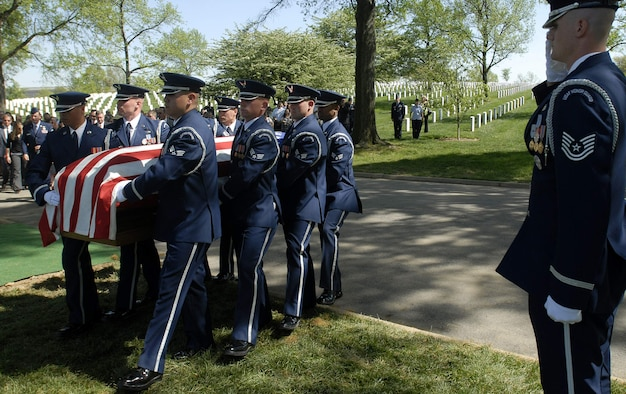 U.S. Air Force Honor Guard Airmen carry the remains of Tech. Sgt. Phillip A. Myers during his funeral April 27 at Arlington National Cemetery. Sergeant Myers, from Hopewell, Va., was killed April 4 in Afghanistan by an improvised explosive device. His family was the first to allow media coverage of the dignified transfer of remains at Dover Air Force Base, Del., since Defense Secretary Robert Gates lifted the 1991 ban April 6. (U.S. Air Force photo/Master Sgt. Stan Parker)