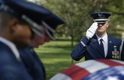Tech. Sgt. Joseph Matulewicz, U.S. Air Force Honor Guard, renders a salute during the funeral for Tech. Sgt. Phillip A. Myers April 27 at Arlington National Cemetery.  Sergeant Myers, from Hopewell, Va., was killed April 4 in Afghanistan by an improvised explosive device. His family was the first to allow media coverage of the dignified transfer of remains at Dover Air Force Base, Del., since Defense Secretary Robert Gates lifted the 1991 ban April 6. (U.S. Air Force photo/Master Sgt. Stan Parker)