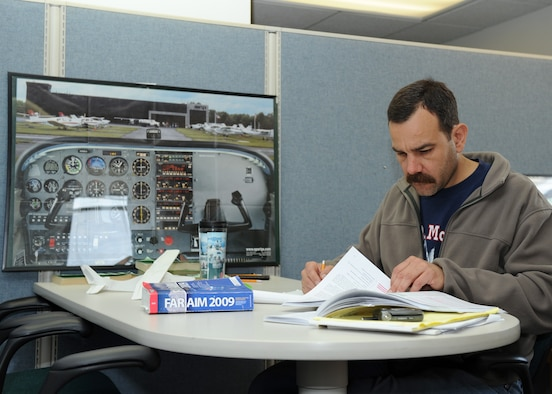 SCOTT AIR FORCE BASE, Ill. --Mr. Tucker, a student at Southwestern Illinois College, and an Aero Club member, studies at the Aero Club for flight instructor certification.(U.S. Air Force photo/Staff Sgt. Paul Villanueva II)