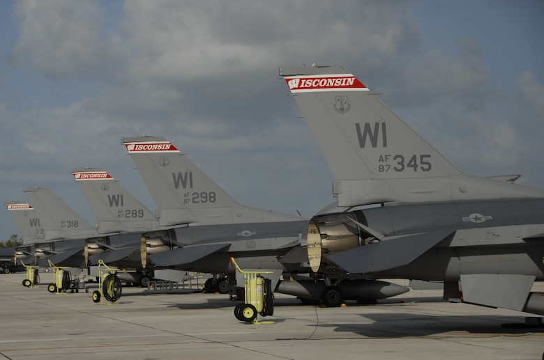 F-16C Fighting Falcons sit lined up on the ramp at Naval Air Station Key West., Fla.   Pilots from the Air National Guard's 115th Fighter Wing in Madison, Wis. honed their air-to-air combat training skills along side their naval counterparts from the Strike Fighter Squadron 2 (VFA-2), Naval Air Station Lemoore, Calif. during a two-week training mission. (U.S. Air Force photo by Master Sgt. Dan Richardson, 115 FW/PA)