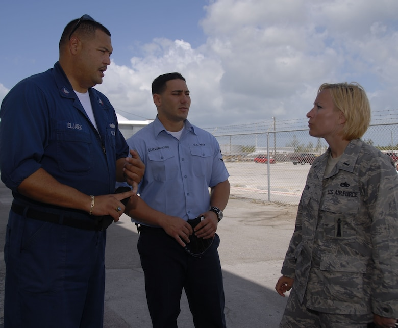 Petty Officers 3rd Class Ernesto Eljaiek and Reynel Echemenia, NAS Key West hazardous materials specialists and fleet liaisons, works with 1st Lt. Christy Kasten, 115th Fighter Wing maintenance officer, on the hangar logistics as the wing prepares to complete their deployment.   The 115th FW participated in an air-to-air combat training skills along side their naval counterparts from the Strike Fighter Squadron 2 (VFA-2), Naval Air Station Lemoore, Calif. during a two-week training mission.  (U.S. Air Force photo by Master Sgt. Dan Richardson, 115 FW/PA)