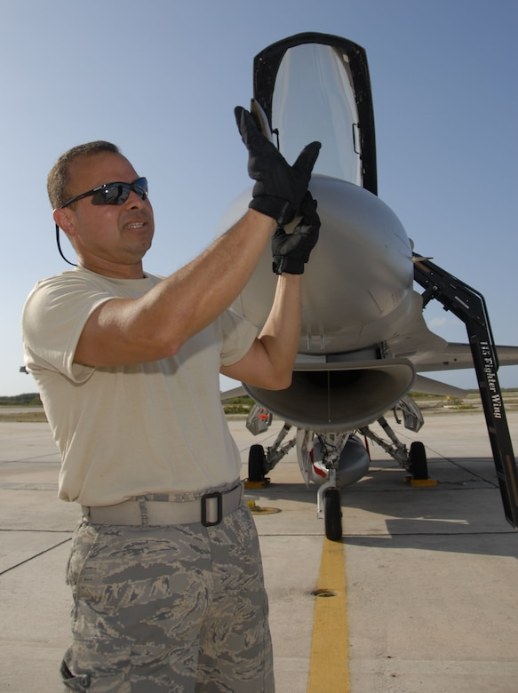 Staff Sgt. Jose Irizarry, a crew chief from the Air National Guard's 115th Fighter Wing in Madison, Wis., inspects an air speed indicator on an F-16C Fighting Falcon prior to flight.  The 115th FW participated in an air-to-air combat training skills along side their naval counterparts from the Strike Fighter Squadron 2 (VFA-2), Naval Air Station Lemoore, Calif. during a two-week training mission.