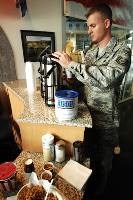 United States Air Force Tech. Sgt. Bret Reinhardt, Defense Media Activity Regional News Center, pours a cup of coffee at the United Service Organizations located in the passenger terminal, Ramstein Air Base, Germany, April 28, 2009. The USO is a private, nonprofit organization whose mission is to support the troops by providing morale, welfare and recreation-type services to our men and women in uniform. (U.S. Air Force photo by Senior Airman Amber Bressler)
