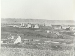 FORT RILEY 1866.  In the fall of 1866, the Seventh United States Cavalry was organized at Fort Riley under the command of Lieutenant Colonel George Armstrong Custer.  At this time, the Quartermaster Department conducted a survey of post buildings that included a photograph of the Main Post area.  This is the earliest known photograph of Fort Riely, taken in the fall of that year.  The building foreground is the post physician's quarters.  This building was torn down in the late 1930s.