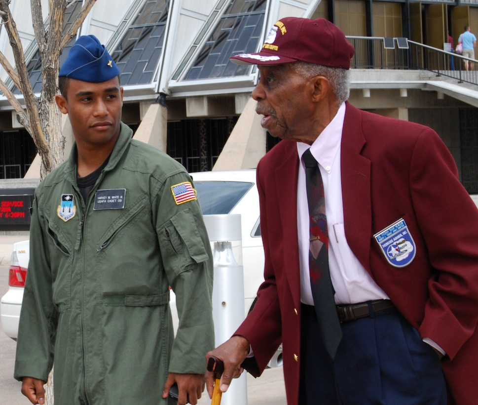 """U.S. Air Force Academy Cadet 1st Class Harvey White III escorts retired Col. Fitzroy """"Buck"""" Newsum, shown here, and other Tuskegee Airmen during their visit to the Academy in Colorado Springs, Colo., April 24. Cadet White, a senior assigned to Cadet Squadron 20, previously escorted Tuskegee Airmen during a 2007 visit. (U.S. Air Force photo/Staff Sgt. Don Branum)"""
