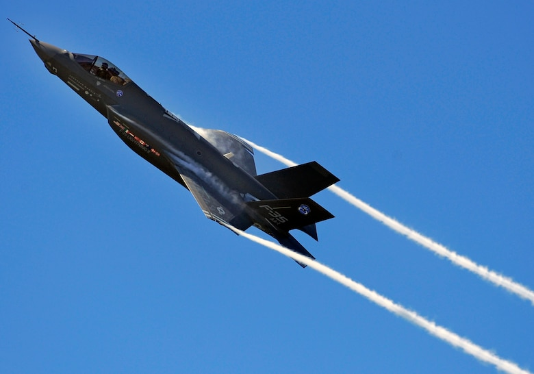 An F-35 Lightning II Joint Strike Fighter test aircraft banks over the flightline at Eglin Air Force Base, Fla., April 23, sending contrails streaming off the wings.  The aircraft is the first F-35 to visit the base which will be the future home of the JSF training facility.  (U.S. Air Force photo/Senior Airman Julianne Showalter)
