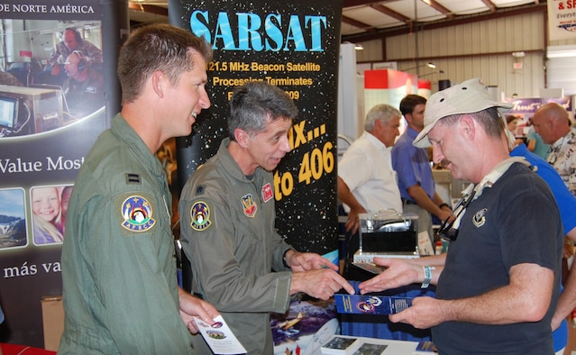 LtCol. Bill Clarke and Capt. Bob Nichols, members of the Air Force Rescue Coordiation Center, educate general aviation pilots and enthusiasts on search and rescue operations in the U.S. and the phase-out of 121.5/243.0 MHz ELT activation notification by the international search and rescue satellite system at this year's Sun 'n Fun fly-in in Lakeland, Fla.