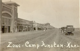 "ARMY CITY.  Army City, Camp Funston, c. 1918.  Called the ""zone"" by the soldiers at Camp Funston, Army City was a commercial area located just east of the army camp alongside the Kansas River on the Pawnee Flats.  The city was about four city blocks in length and it was built expressly for the purposes of entertaining the soldiers.  The area consisted of hotels, clothing stores, a movie theater, pool hall, and an arcade.  Army City ceased to exist in the early 1920s when many of the businesses were destroyed by a fire."
