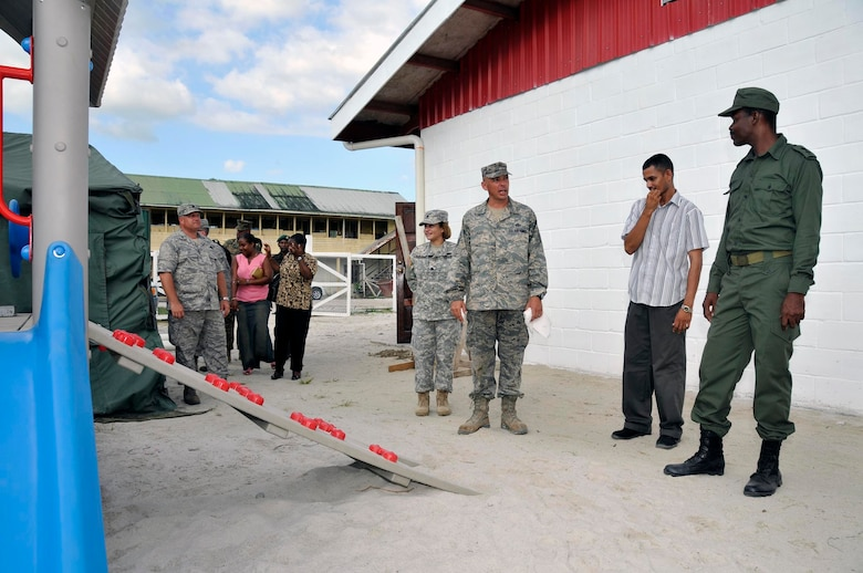 Senior Master Sgt. Scott Lacey, a project manager with the 301st Civil Engineer Squadron, Naval Air Station Joint Reserve Base Fort Worth, Texas, speaks with members of the Guyana Defense Force and Guyana Ministry of Education, during a tour of Timehri Nursery school July 29, 2009 in Georgetown, Guyana. Sergeant Lacey and his Airmen recently completed renovations to the school house, which included two playground sets, new septic system, and repainting the outside and inside of the building. (U.S. Air Force photo by Airman 1st Class Perry Aston) (Released)
