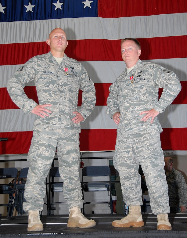 Tech. Sgt. Kevin Bullivant and Tech. Sgt. Barry Duffield from the 151st Air Refueling Wing, Utah Air National Guard, pose with their Bronze Stars in front of the American flag after an awards ceremony on August 1.  The sergeants were awarded the medals on August 1 for serving as team leaders in the 506th Explosive Ordnance Disposal (EOD) Flight while deployed to Kirkuk Air Base, Iraq.  The deployment was in support of Operation Iraqi Freedom. U.S. Air Force photo by Staff Sgt. Emily Monson.