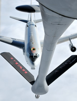 A Utah Air National Guard KC-135 tanker refuels a NATO E-3 Sentry AWACS above northern Germany July 29 during an air refueling training mission. The Utah Air National Guard is deployed for a two-week rotation to Geilenkirchen Air Base in Germany to support the NATO AWACS missions. U.S. Air Force photo by Airman 1st Class Lillian Chatwin.