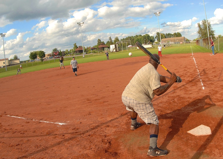 SPANGDAHLEM AIR BASE, Germany -- Dexter High, 52nd Aircraft Maintenance Squadron, takes a swing at the ball during an intramural softball game July 30. The 52nd Aircraft Maintenance Squadron finished the 2009 season with 12 wins and 8 losses. They were knocked out of a championship berth by the Security Forces team here July 30. (U.S. Air Force photo by Airman 1st Class Nick Wilson)
