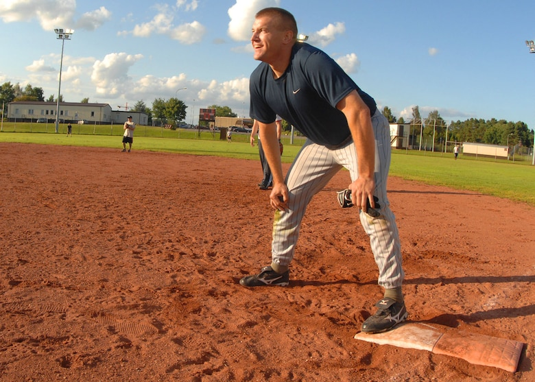 SPANGDAHLEM AIR BASE, Germany -- Michael Dean, 52nd Security Forces Squadron, waits for his chance to run to second here July 30. The Security Forces intramural softball team defeated the Aircraft Maintenance Squadron 20-15 in the National League Semifinals to play the Component Maintenance Squadron-A team for the Championship here. The Component Maintenance Squadron-A team won the 209 National League Championships by defeating SFS 14-12.  (U.S. Air Force photo by Airman 1st Class Nick Wilson)