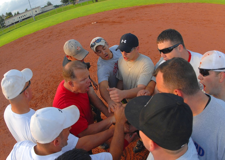 SPANGDAHLEM AIR BASE, Germany --The 52nd Component Maintenance Squadron-A team shouts their squadron chant after winning the 2009 National League Championship here July 30. The intramural softball team defeated Security Forces in the seventh inning 14-12 to win the game. (U.S. Air Force photo by Airman 1st Class Nick Wilson)