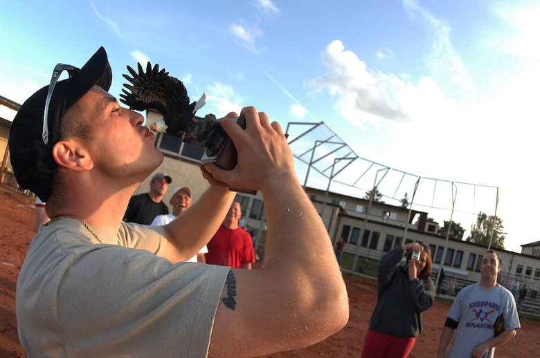SPANGDAHLEM AIR BASE, Germany -- Robert Marcy, 52nd Component Maintenance Squadron aerospace propulsion technician, kisses his team's trophy after winning the 2009 National League Championship for intramural softball here July 30. The Component Maintenance Squadron-A  team defeated Security Forces 14-12. (U.S. Air Force photo by Airman 1st Class Nick Wilson)