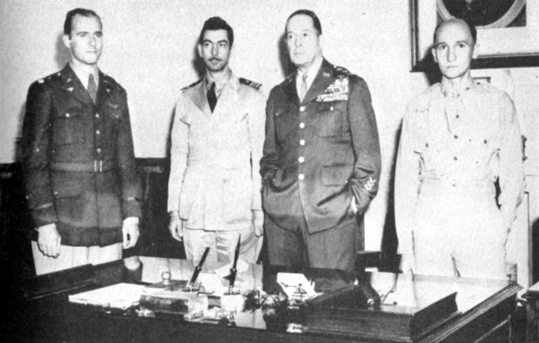 Lt. Col. William E. Dyess (left) reporting to Gen. MacArthur (second from right). Also pictured are two of his fellow escapees, Lt. Cmdr. M.H. McCoy (second from left) and Maj. S.M. Mellnik. (U.S. Air Force photo)