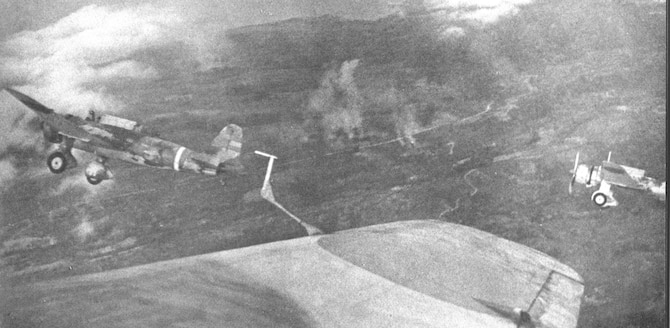 """Japanese Army """"Ann"""" bombers over the main line on Bataan. With almost total air superiority, Japanese aircraft roamed over the PACR at will. (U.S. Air Force photo)"""