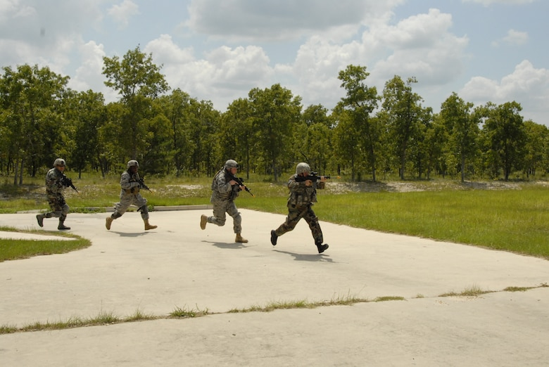 Combat weather Airmen train in combat patrolling at Camp Blanding Joint Training Center, Fla. The combat patrol training is part of exercise Cyclogenesis, a training exercise designed to prepare combat weather Airmen for deployment with the Army. (Air National Guard photo by TSgt. Jeffrey Trumble)