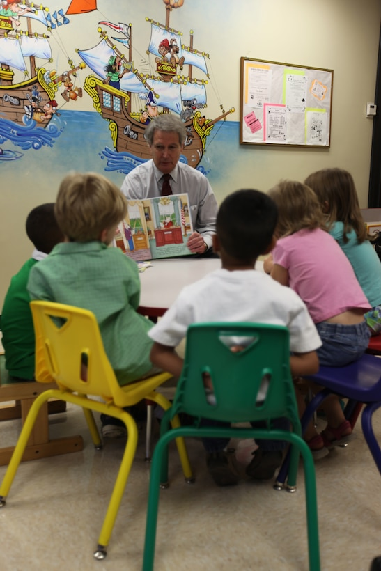U.S. Rep. Walter B. Jones (R-N.C.) visited Naval Hospital Camp Lejeune's Pediatric Clinic to read a few books to a small group of children as part of the Reach Out and Read program, Aug. 4. The Reach Out and Read program is a national, non-profit organization, which began in 1989. The program targets children ages 6 months to 5 years old. The pediatric primary care provider gives a new age and development-appropriate children's book to the child at their pediatric checkups for them to keep and take home with them. Then the care provider encourages parents to read aloud to their young children at home.