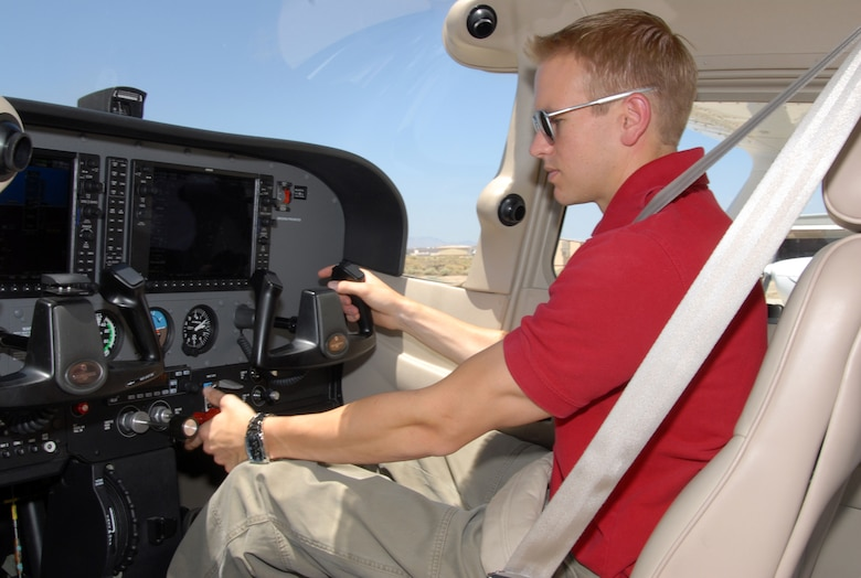 Tim Taylor, Edwards Aero Club full-time flight instructor, checks the cockpit of a Cessna aircraft. Aero Club provides many stages of flight training, from introductory flight to solo, then on to private, commercial and instructors' ratings. (U.S. Air Force photo/Senior Airman Julius Delos Reyes)