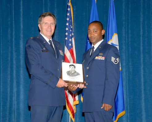 McGHEE TYSON AIR NATIONAL GUARD BASE, Tenn. - Staff Sgt. Telshaun M. Davis,an avionics systems journeyman, from the 172nd Airlift Wing in Jackson,Miss., receives the John L. Levitow Award from Col. Richard B. Howard,commander of the I.G. Brown Air National Guard Training and Education Centerduring the graduation ceremony of the Paul H. Lankford Enlisted ProfessionalMilitary Education Center's Airman Leadership School Class 09-4, July 30,2009. (U.S. Air Force photo by Master Sgt. Kurt Skoglund)(Released)