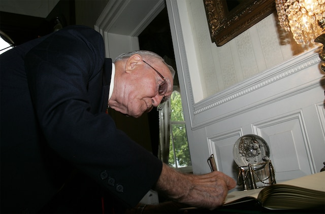 Retired Air Force Col. George 'Bud' Day, Medal of Honor recipient, signs the visitor log during his visit to the commandant of the Marine Corps' home at Marine Barracks 8th and I Aug. 3. Day has served in three different military services, including the Marine Corps, during three different wars and is America's most decorated living military officer.  During his time as an Air Force pilot in Vietnam, Day was captured by North Vietnam forces. During his captivity he escaped, becoming the only prisoner of war to do so, but after two weeks of evasion, he was recaptured by Viet Cong forces. He was finally released in 1973.