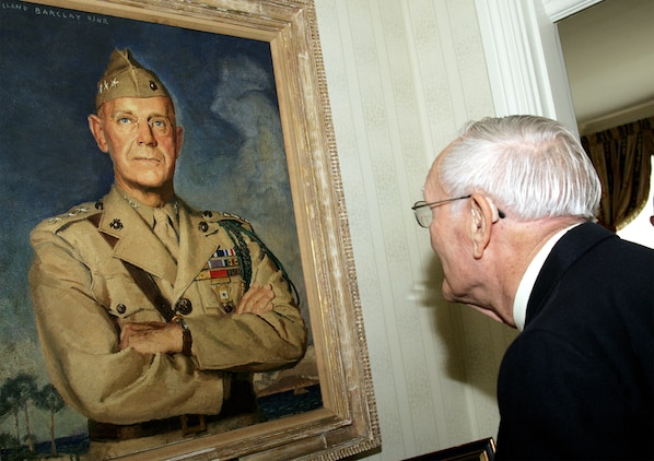 Retired Air Force Col. George 'Bud' Day, Medal of Honor recipient, admires the painting of Lt. Gen. Thomas Holcomb, the 17th commandant of the Marine Corps who was commandant when Day enlisted into the Marine Corps in 1942. During Day's visit at the CMC's home at Marine Barracks 8th and I Aug. 3, he said he was overwhelmed with nostalgia.  Day has served in three different military services, including the Marine Corps, during three different wars and is America's most decorated living military officer.  During his time as an Air Force pilot in Vietnam, Day was captured by North Vietnam forces. During his captivity he escaped, becoming the only prisoner of war to do so, but after two weeks of evasion, he was recaptured by Viet Cong forces. He was finally released in 1973.