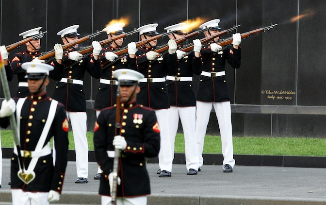 Marines with the Silent Drill Platoon fire three shots during the playing of Taps in honor of the fallen service members from America's wars at the Marine Corps War Memorial Aug. 3. The night's guest of honor was Medal of Honor recipient retired Air Force Col. George 'Bud' Day. Day has served in three different military services, including the Marine Corps, during three different wars and is America's most decorated living military officer.  During his time as an Air Force pilot in Vietnam, Day was captured by North Vietnam forces. During his captivity he escaped, becoming the only prisoner of war to do so, but after two weeks of evasion, he was recaptured by Viet Cong forces. He was finally released in 1973.