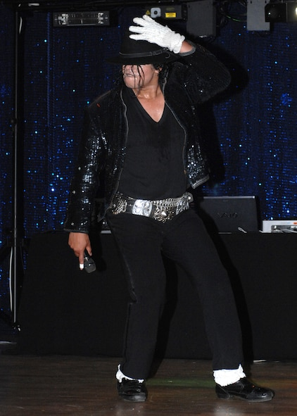 "SPANGDAHLEM AIR BASE, Germany -- ""Michael Jackson"" performs during his performance at the Michael Jackson Tribute Aug. 1 at the Brick House. The tribute included a performance by a Michael Jackson impersonator, a disc jockey, coloring sheets, music videos and a dance contest. The performance included multiple costume changes, dancing and featured hits such as ""Thriller"" and ""Billy Jean"". (U.S. Air Force photo by Senior Airman Jenifer H. Calhoun)"
