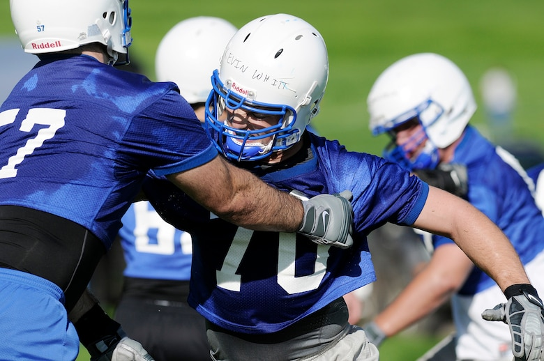 Air Force Academy senior offensive linesman Nick Charles blocks sophomore Kevin Whitt during football practice Aug. 4 in day 2 of football practice at the Academy practice field.  Charles was recently named a preseason first-team all-Mountain West Conference selection.  The Falcons host the Nicholls State Colonels Sept. 5 in their home opener.  (U.S. Air Force photo/Mike Kaplan)