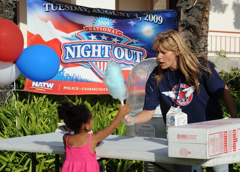 A family member gets a snow cone at the National Night Out event at Fort MacArthur, Aug. 4. Families gathered to enjoy food, meet Mc Gruff the Crime Dog and local fire department reps, and other activities in observance of the event where neighborhoods across the country take back the night from crime.  (Photo by Joe Juarez)