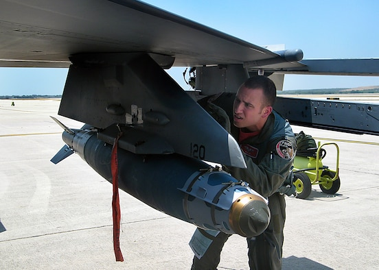 "Capt. Keith ""KRACR"" Krejchik, an F-16 instructor pilot with the Wisconsin Air National Guard's 115th Fighter Wing, inspects a GBU-38 Joint Direct Attack Munition (JDAM) just prior to flying from Kelly Field, Lackland Air Force Base, Texas, to the McMullen Target Complex in South Texas on July 17, 2009. Capt. Krejchik is undergoing instructor pilot upgrade training with the 149th Fighter Wing, Texas Air National Guard. (Air National Guard photo/SSgt Phil Fountain)(RELEASED)"
