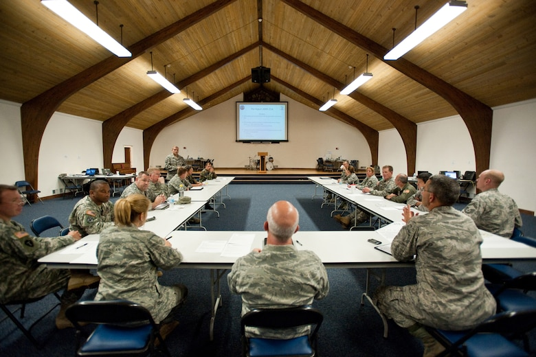 Joint Task Force Cardinal officials receive a status update of current operations at the Kentucky Air National Guard Base on Aug. 5 as part of a statewide pandemic-response exercise.