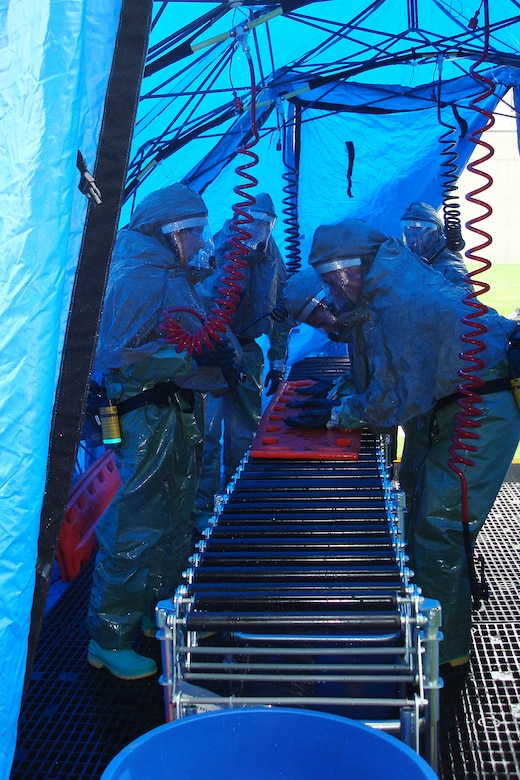 Members of the Kentucky Air Guard's 123rd Medical Group set up a portable decontamination system at Woodford Memorial Hospital in Versailles, Ky., Aug. 5 as part of a statewide pandemic-response exercise.